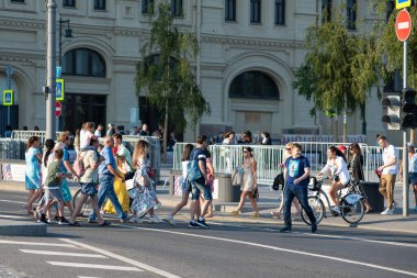 Moscow, Russia, July 11, 2020 - A crowd of people walking along a pedestrian crossing in the center of Moscow