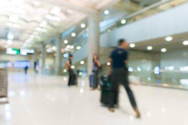 Blur of passenger walking  at airport building