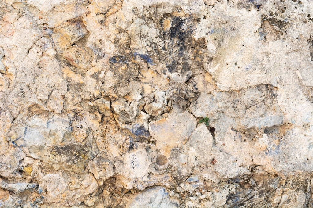 Bright stone wall texture background closeup, fragment from fort in Alanya, Turkey