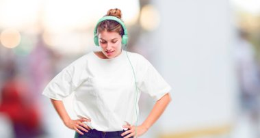 young beautiful girl dancing and listening music with headphones.