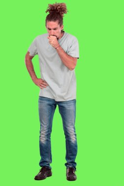 Young bearded man full body gesturing against chroma key green background. Ready to cut out.