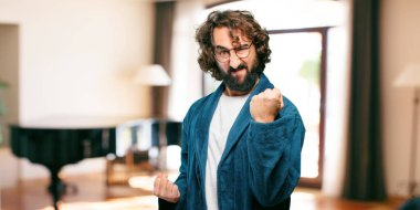 young man wearing bathrobe night suit in angry pose