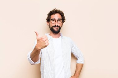 young cool bearded man with okay gesture and satisfied expressio