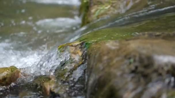 Close up shot of the mountain river in slow motion.