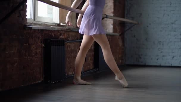 Legs of a ballerina are training in slow motion.