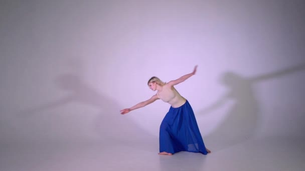 A blonde girl dancing contempo in studio in slow motion