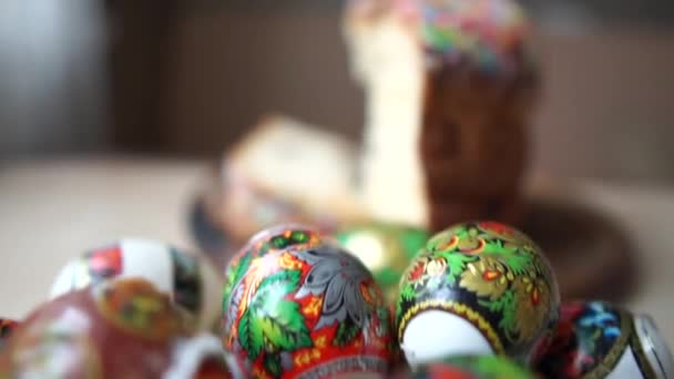 Macro shot - Camera moves from easter eggs to easter that lie on the table.