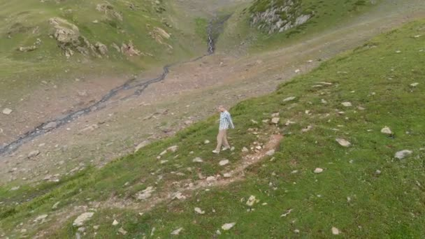 4k - The guy quickly goes down the mountain, aerial action with drone