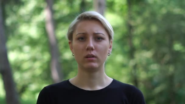 Strained blond woman with deep eyes full of romantic expectation in slo-mo