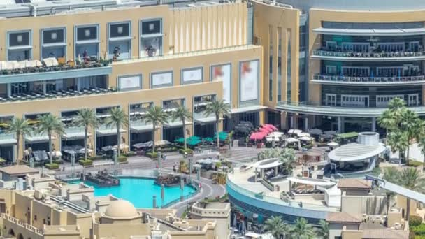 Balcony of shopping mall and pool of fountains timelapse in Dubai, United Arab Emirates