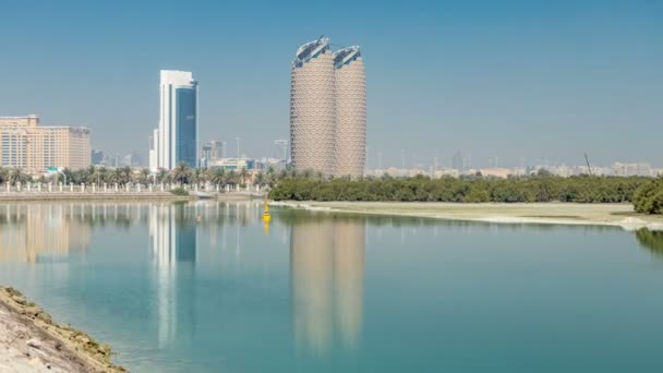 View of skyscrapers skyline with Al Bahr towers in Abu Dhabi timelapse. United Arab Emirates