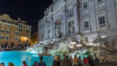 The famous Trevi Fountain at night timelapse hyperlapse. This place is one of the most visited in Rome. Crowd stay agound.