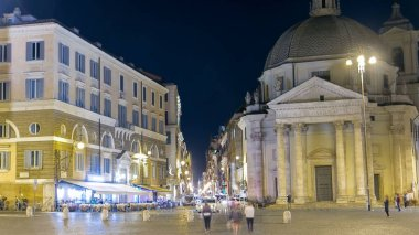Piazza del Popolo timelapse with twin churches of Santa Maria in Montesanto and Santa Maria dei Miracoli Piazza del Popolo at night. Rome, Italy. View to street from fountain