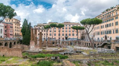 Largo di Torre Argentina timelapse in Rome. It is a square that hosts four Republican Roman temples, and the remains of Pompeys Theatre. Cloudy sky and historic buildings around