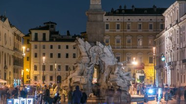 Fountain of the Four Rivers timelapse, Piazza Navona Rome, Fontana di Quattro Fiume, Bernini marble sculpture. Tourists and illuminated old buildings on the background