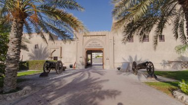 Historic fort at the Museum of Ajman timelapse hyperlapse with blue cloudy sky, United Arab Emirates 4K