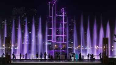 Evening Musical fountain show. Singing fountains in Sharjah timelapse, UAE 4K