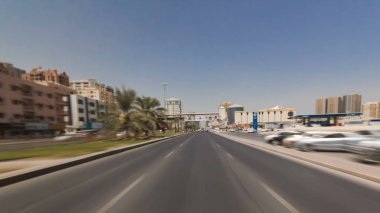Drive on the streets of Ajman timelapse hyperlapse at day time.  Ajman is the capital of the emirate of Ajman in the United Arab Emirates. 4K