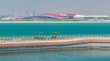 Ferrari world view in Yas Island Abu-Dhabi timelapse. View from water at sunny day