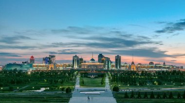 Panorama of the Astana city day to night transition timelapse and the president's residence Akorda with park. View from the Palace of Peace and Reconciliation. Astana, Kazakhstan. 4K