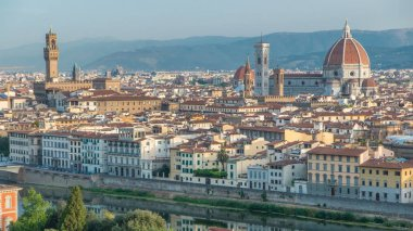 Palazzo Vecchio timelapse on piazza della Signora and Basilica di Santa Maria del Fiore in the morning as seen from Piazzale Michelangelo. Florence, Italy. Mountains on background. Aerial top view