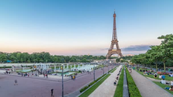 Evening view of Eiffel Tower day to night timelapse with fountain in Jardins du Trocadero in Paris, France.