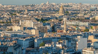 Aerial panorama above houses rooftops in a Paris timelapse. Evening view with les invalides and long shadows bebore sunset