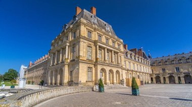 Beautiful Medieval landmark - royal hunting castle Fontainbleau timelapse hyperlapse with monument. Palace of Fontainebleau - one of largest royal chateaux in France, UNESCO World Heritage Site.