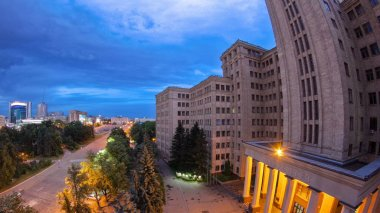 The building of Karazin Kharkiv National University day to night transition timelapse in a summer evening. One of the oldest universities in Ukraine is The Karazin University aerial view