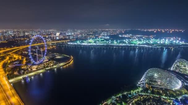 Panoráma Singapuru s slavný Singapur ruským kolem noční timelapse