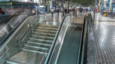 Exit from metro to La Rambla street in Barcelona night timelapse hyperlapse, Spain. Thousands of people walk daily by this popular pedestrian area. Stairs and escalators