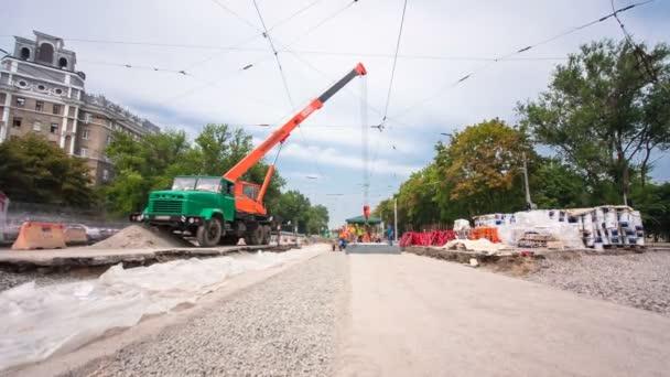 Installing concrete plates by crane at road construction site timelapse hyperlapse.