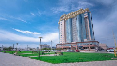 Modern residential buildings in city Atyrau timelapse hyperlapse. Blue cloudy sky at sunny day. Kazakhstan