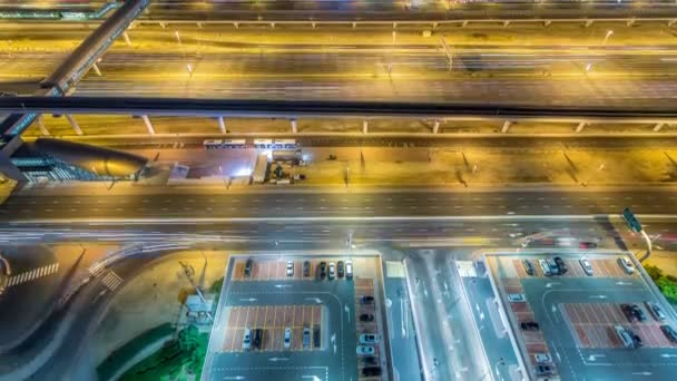 Sheikh Zayed Road traffic in Dubai Marina and Jumeirah Lakes Towers districts night timelapse