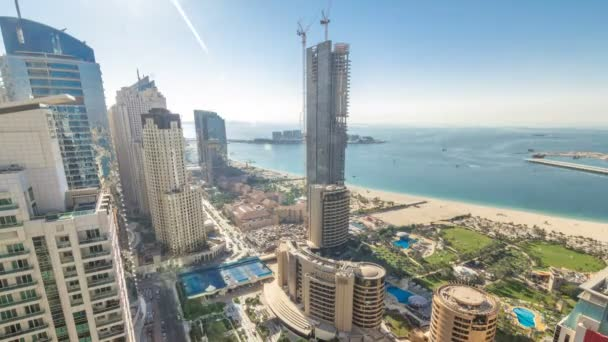 Aerial view of modern skyscrapers and beach at Jumeirah Beach Residence JBR timelapse in Dubai, UAE