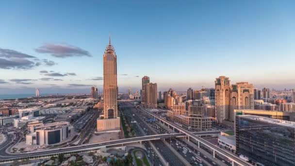 Skyline internet city with crossing Sheikh Zayed Road aerial day to night timelapse