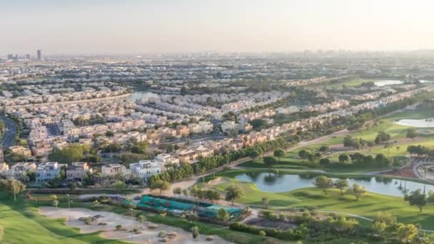 Aerial view to villas and houses with Golf course with green lawn and lakes timelapse