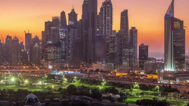 Dubai Marina skyscrapers and golf course day to night timelapse, Dubai, United Arab Emirates
