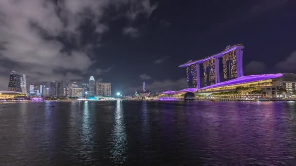 Beautiful laser and musical fountain show at the Marina Bay Sands waterfront in Singapore night timelapse