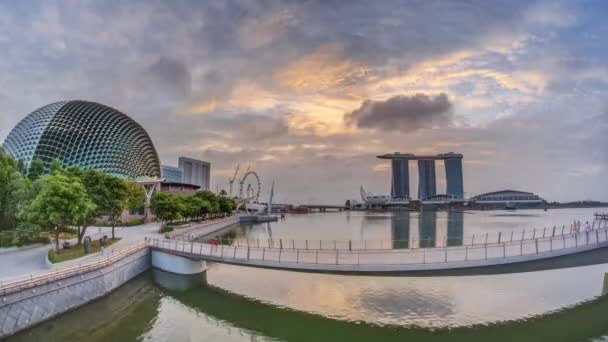 Skyline in Marina Bay with Esplanade Theaters on the Bay and Esplanade footbridge early morning timelapse in Singapore.