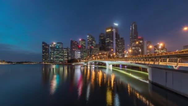 Esplanade bridge and downtown core skyscrapers in the background Singapore night to day timelapse