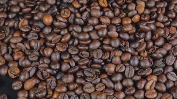 Roasted coffee beans background. Aromatic roasted coffee close up