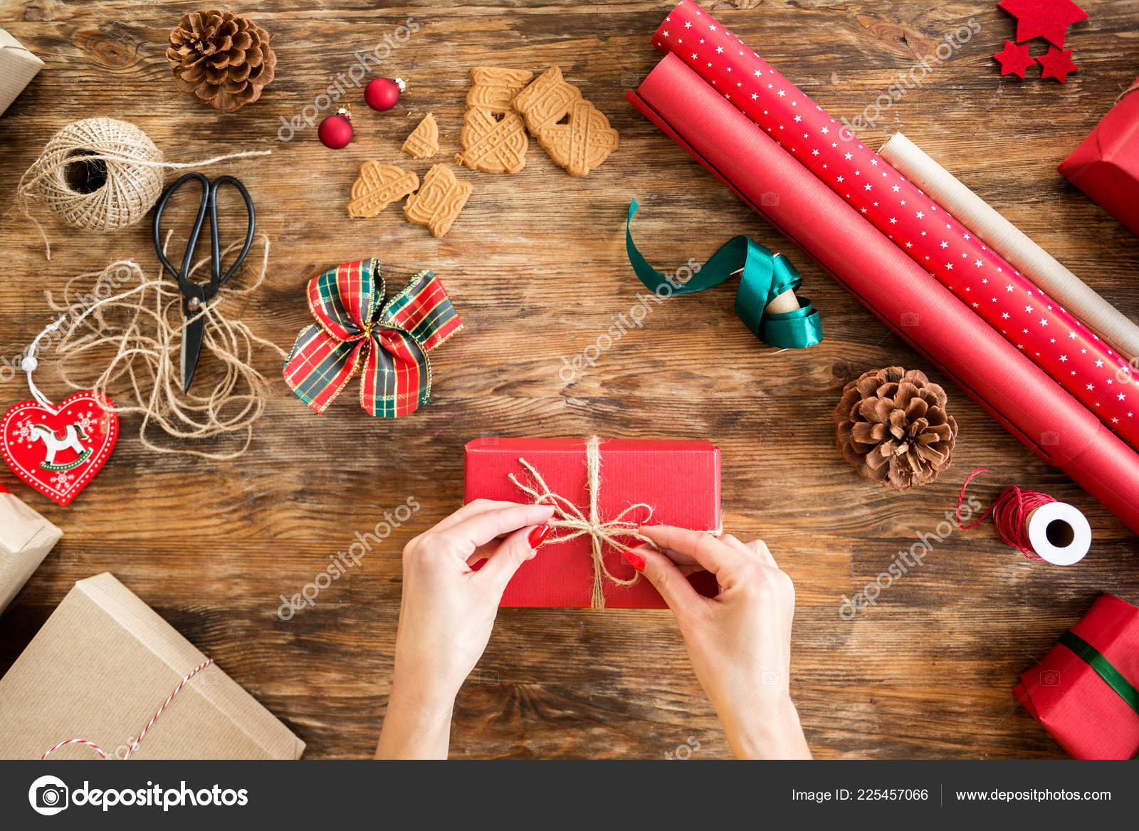 Christmas Gift Wrapping Station.Diy Gift Wrapping Woman Wrapping Beautiful Red Christmas