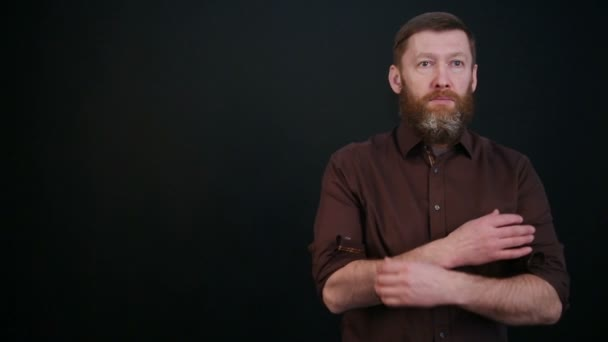 Young bearded man looking at the camera