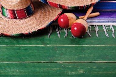 Mexico sombrero fiesta cinco de mayo wood background mexican maracas