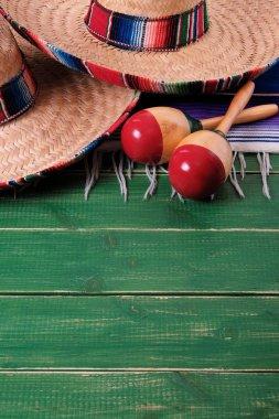 Mexico sombrero fiesta cinco de mayo wood background mexican maracas vertical