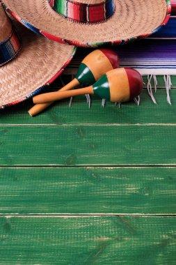 Mexico sombrero border mexican maracas old green wood background vertical