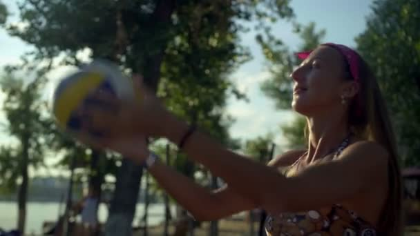 Happy woman play volleyball on beach