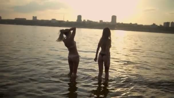 Women walking and swimming in water