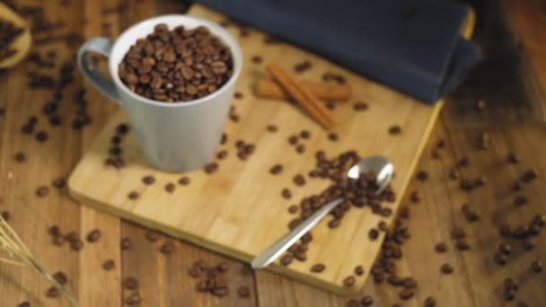Cup with roasted coffee beans on table